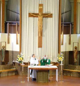 priest celebrating the Eucharist